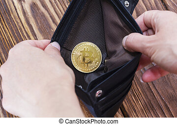 Bitcoin gold coins with wallet, close-up. Virtual cryptocurrency concept.