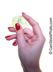 Bitcoin in a beautiful woman's hand.