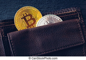 Bitcoin in brown leather wallet. Bitcoin, modern virtual cryptocurrency. Profit from mining crypto currencies. Bitcoin gold coins with wallet, close-up. Virtual cryptocurrency concept.