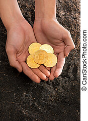 Bitcoin in the heart-shaped hand, electronic virtual money for web banking and international network payment.