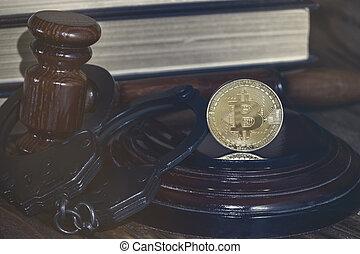 bitcoin, judge's hammer, handcuffs. Concept bitcoin ban, violation of the law.