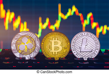 Bitcoin, litecoin and ripple coins currency finance money on graph chart background. Bitcoin as most important cryptocurrency concept. Stack of cryptocurrencies with a golden bitcoin in the middle.