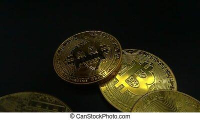 Bitcoin macro symbol sign close-up slowmo - Falling Bitcoin...