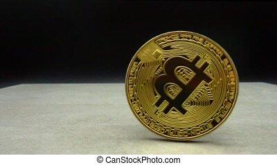 Bitcoin macro symbol sign close-up slowmo - Rotating Bitcoin...