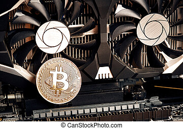 Bitcoin. New virtual money. Bitcoins lie on the video card, concept of mining. Flat lay. Top view. Still life