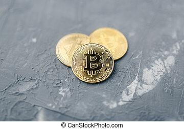 bitcoin on a blue background, coin bitcoin on the table