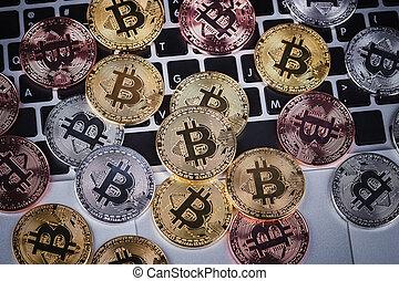 bitcoin on a laptop keyboard computer
