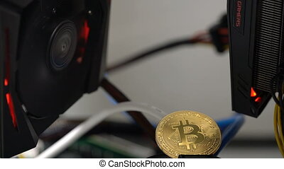 bitcoin on the background of a graphics card in a rack for crypto-currency mining
