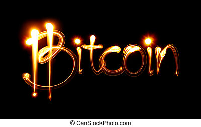 Bitcoin sign and word over black background. Light painting
