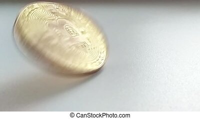 bitcoin spinning in slow motion on white background