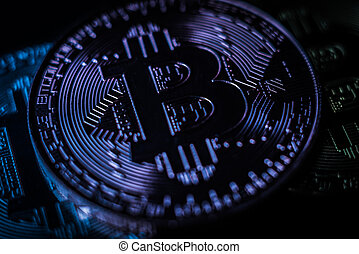 Bitcoin with bit symbol in blue light