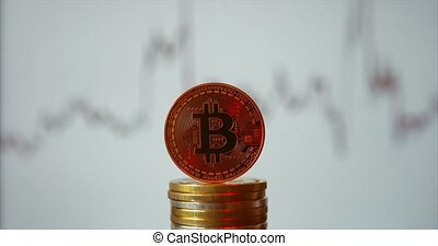 Bitcoin with red backlight on light background.