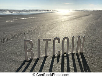 Bitcoin word in Sand with Shadows by Sun. Concept od New...