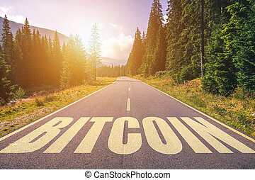Bitcoin word written on road in the mountains
