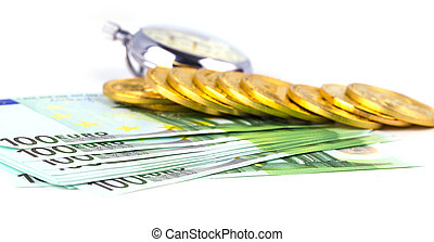 bitcoins on a pile of one hundred euros and a bulb clock on white background