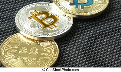 Bitcoins on black background. Crypto currency