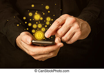 Bitcoins on smartphone - Hand holding smart phone mobile ...