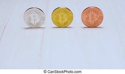 Bitcoins on white table