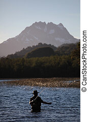 Bite - A fly fisherman practices his craft on a pristine...