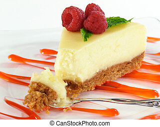 Bite of Cheesecake - Cheesecake with raspberries and sauce.