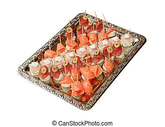 Variety of bite-sized canapes on a tray