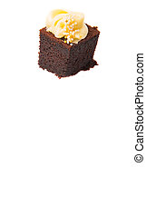 Bite sized chocolate cake with cream cheese toppings over white background