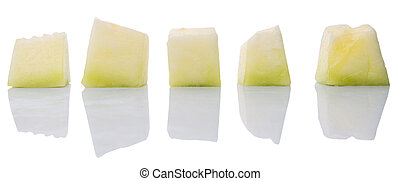 Bite sized honeydew pieces over white background