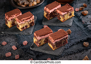 Bite sized marble cake with cocoa powder on top