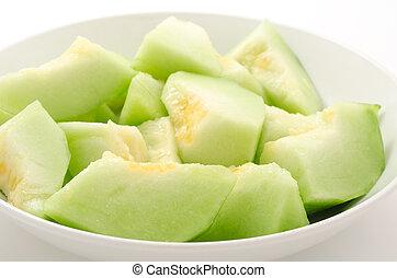 Bite sized melon - Many bite sized cut melon on the plate