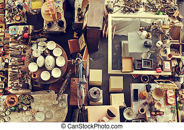 bits and pieces in a flea market - aerial view of a stall in...