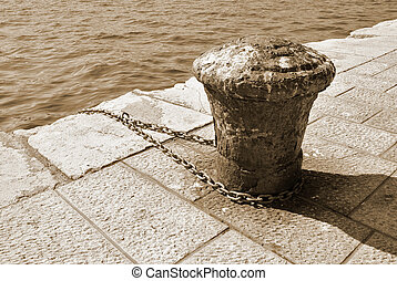 bitt with chain on the pier