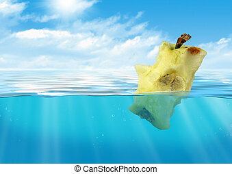 Bitten apple floating at water, reservoir pollution concept...