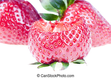 Bitten strawberry, isolated on white