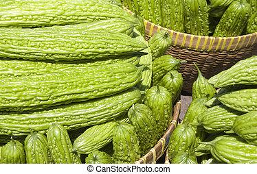 Bitter gourd (bitter melon); a l long green bitter vegetable