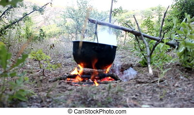 Bivouac. Cooking on fire during hike - Field kitchen....