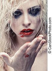 Bizarre beauty - Blond lady with strange makeup. Vertical...
