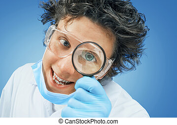 Bizarre scientist looks through a magnifying glass