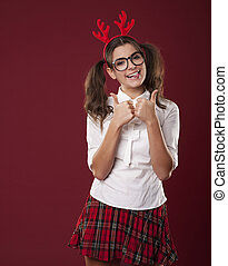 Bizarre woman with christmas horns showing thumbs up