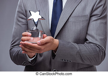 biznesmen, dzierżawa, gwiazda, nagroda, w, handlowe pojęcie