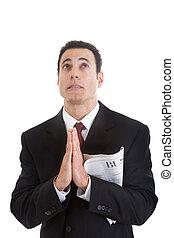 biznesmen, dzierżawa, handlowa sekcja, gazeta, przeglądnięcie do góry, modlący się