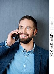 biznesmen, rozmowa telefoniczna, szczęśliwy