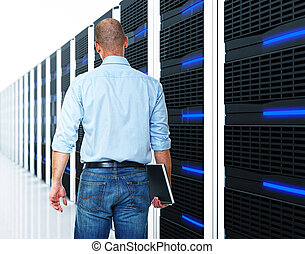 black 3d server and man - caucasian man and datacentre with...