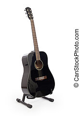 Black acoustic guitar on stand, isolated