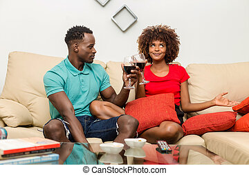 Black African American couple drinking wine in the living room
