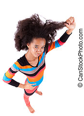 Black African American teenage girl holding her afro hair