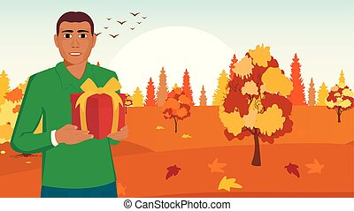 Black African American with Christmas gift in box on autumn landscape background