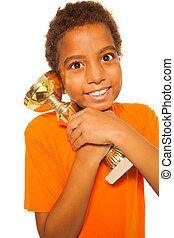 Black African boy with winners cup prize