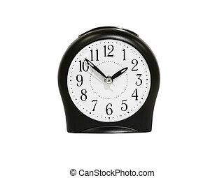 Black alarm clock.