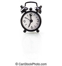Black alarm clock showing seven