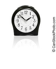 Black alarm clock with reflection.